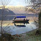 A Pletna wooden rowing boat on Lake Bled Slovenia by John Keates