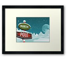 North Pole sign in a snowy Christmas scene. Framed Print