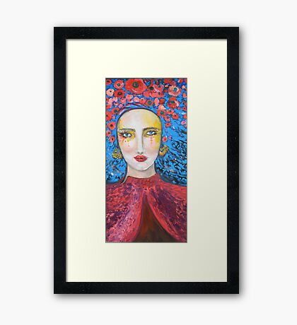 Woman with poppies in her hair Framed Print