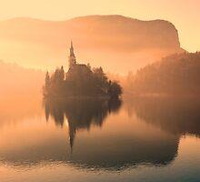 Church in mist on Lake Bled Slovenia by John Keates