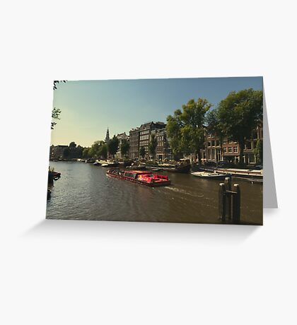 The red canal boat headed towards the light Greeting Card