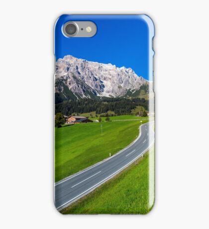 Alpine countryside road in green fields, Austria iPhone Case/Skin
