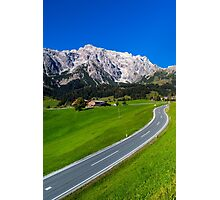 Alpine countryside road in green fields, Austria Photographic Print