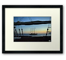 Two sailing boats at sea in Santorini, Greece. Framed Print