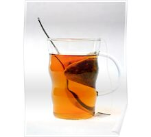 Glass cup of tea. The Tea bag can be seen in the cup Poster