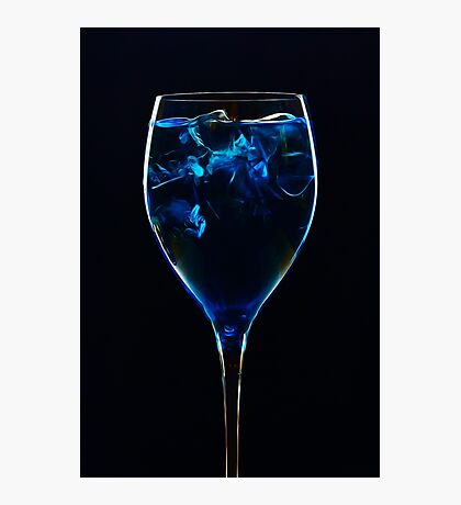Amazing blue cocktail with ice cubes close up on dark background Photographic Print