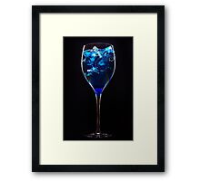 Amazing blue cocktail with ice cubes on dark background Framed Print