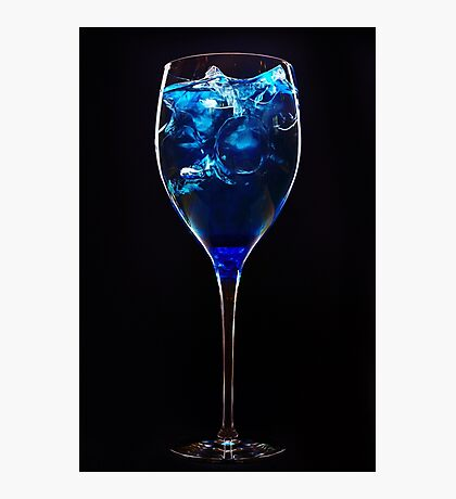 Amazing blue cocktail with ice cubes on dark background Photographic Print