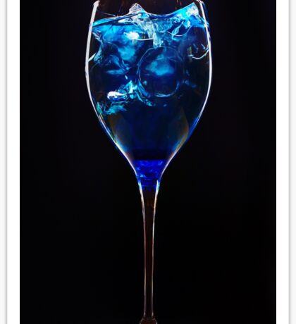 Amazing blue cocktail with ice cubes on dark background Sticker