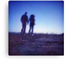 Romantic couple walking holding hands on beach in blue Medium format color negative film photo Canvas Print