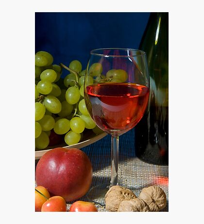 Classic still life featuring a colorful bowl of fruit and a wine bottle Photographic Print