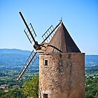 Old stone windmill in Provence, France by dvoevnore