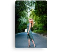 Young blonde girl dancing on the road Canvas Print