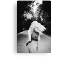 Blonde girl dancing on the road. Black and white. Canvas Print
