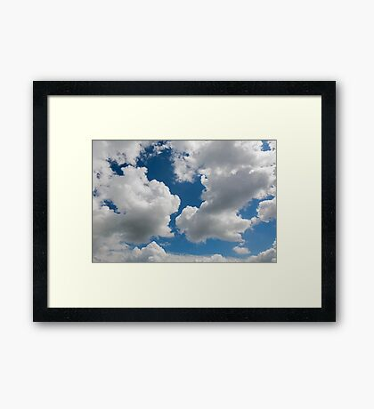 raised clouds on a blue sky Framed Print