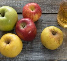 Apple cider in  bottle,  and fresh apples on wooden background Sticker