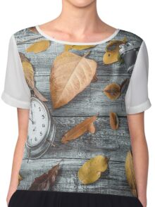 Autumn leaves camera and alarm clock on wooden table.Retro concept Chiffon Top