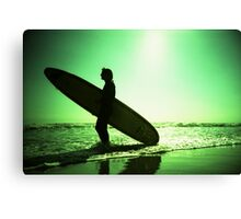 Surfer carrying surfboard in surreal silhouette in green in sea ocean water by beach 35mm analog xpro cross lomo lca photo Canvas Print