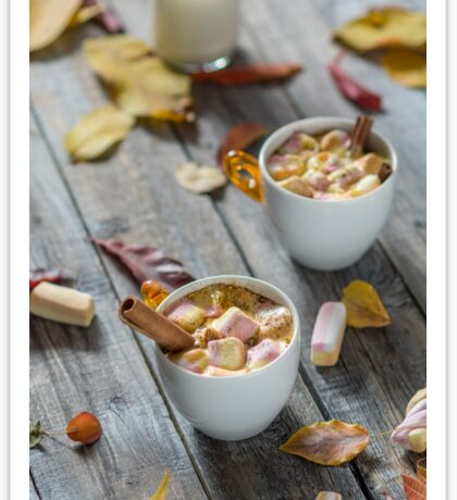 Homemade hot chocolate with marshmallows and cinnamon stick.Shallow depth of field Sticker