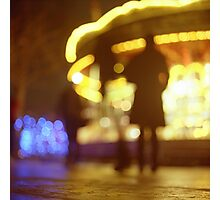 People walking in street at night with fairground lights in Hasselblad vintage camera analogue film photo Photographic Print