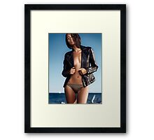 Sexy young woman in leather jacket over half-naked body at the beach art photo print Framed Print