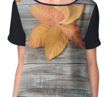 Autumn background. Autumn leaves over wooden background. Thanksgiving day concept Chiffon Top