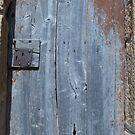 Worn and Rusty Wooden Door by pjwuebker