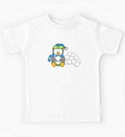 Little penguin sitting with snow balls Kids Tee