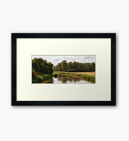 at the riverside Framed Print