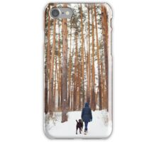 Woman in warm clothes playing with dog iPhone Case/Skin