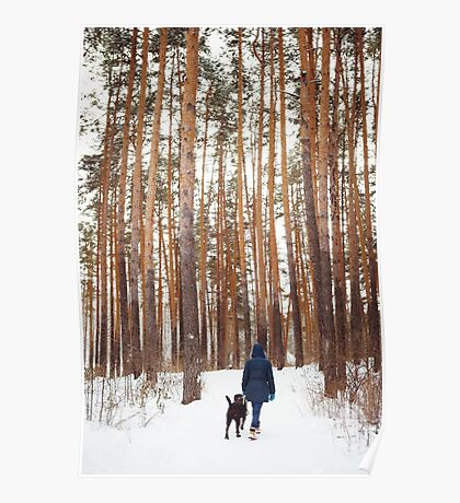 Woman in warm clothes playing with dog Poster