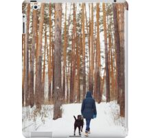 Woman in warm clothes playing with dog iPad Case/Skin