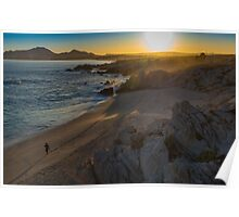 Walking alone on the beach at sunset Poster