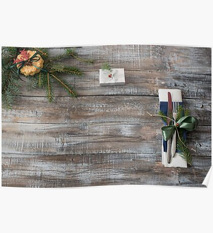 Christmas table place setting with christmas tree branches spoon knife fork and ribbon over wooden table with copy space Poster