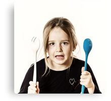 Preschooler girl playing with spoons for salad, isolated on white background Canvas Print