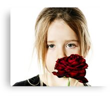 Cute little girl portrait with red rose, isolated on white background Canvas Print