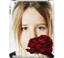 Cute little girl portrait with red rose, isolated on white background iPad Case/Skin