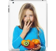 Cute little girl with plate of fruits: kiwi, date plum, mandarins, etc., isolated on white background iPad Case/Skin