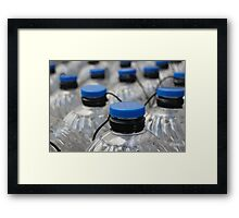 plastic bottles with blue lids  Framed Print
