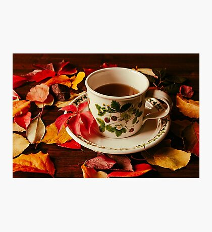 Cup of tea and autumnal foliage Photographic Print