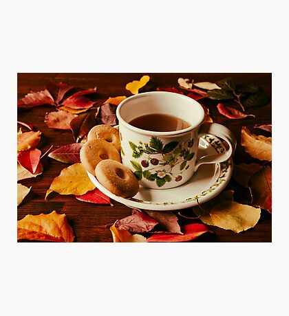 Cup of tea with biscuits and autumnal foliage Photographic Print