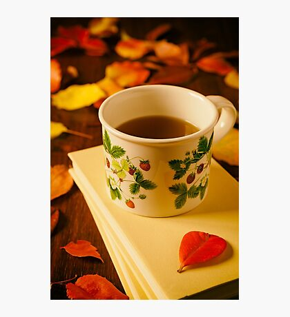 Cup of tea, books and colorful autumnal foliage Photographic Print