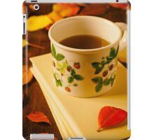 Cup of tea, books and colorful autumnal foliage iPad Case/Skin