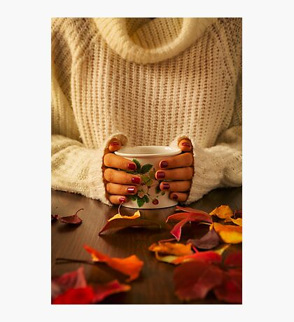 Woman hands holding teacup and autumnal foliage Photographic Print