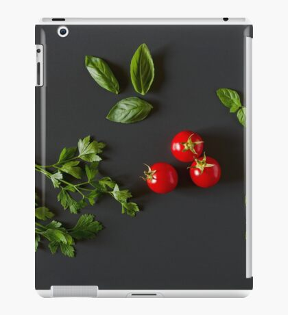 Green vegetables around three red tomatoes iPad Case/Skin