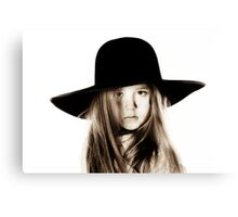 LIttle girl posing like a model in mother's hat, isolated on white background Canvas Print