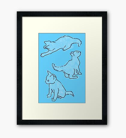 Kitty playing on blue Framed Print
