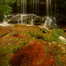 Somersby Falls with copper puddle by Michael Matthews