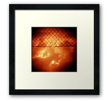 Wire mesh fence against stormy sky silver gelatin black and white medium format 120 6x6 negative analog film photo in sepia tones Framed Print