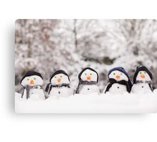 Five cute snowmen dressed for winter Canvas Print